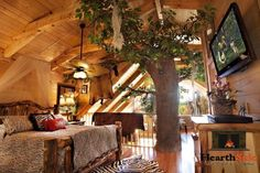 "VIEWS, VIEWS, AND MORE VIEWS -- One-Of-A-Kind, simply incredible jungle and log decor. After staying here, you will feel like you ARE Tarzan and Jane! Upon entering the main level you will discover a 20-Ft. TREE built inside the middle of the cabin. Come relax in the Leopard living room, while gazing at the warm, cozy wood burning ""tree"" fireplace and its uniquely carved mantle.#Pigeon #Forge #honeymoon #anniversary #getaway #romantic #couples #cabin"