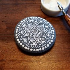 Mandala Painted Pebble by MagaMerlina, via Flickr