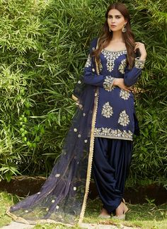 Navy Blue and Gold Embroidered Punjabi Suit features a taffeta silk kameez with santoon inner, santoon bottom and net dupatta. Embroidery work is completed with zari, sequins, stone and lace embellishments. Indian Fashion Trends, Punjabi Fashion, India Fashion, Bollywood Fashion, 50 Fashion, Bridal Fashion, Modest Fashion, Fashion Styles, Fashion Boots