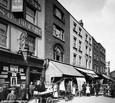 Earlham Street, Seven Dials, London, circa 1905. And here is how it looks now: http://i.dailymail.co.uk/i/pix/2010/03/18/article-1258785-086ADC43000005DC-788_470x423.jpg