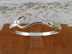 Fish Hook Bracelet. $199.95, via Etsy.