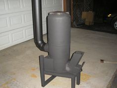 """DIY Rocket Stove Heater with hot water and hot air exchanger! This will heat your domestic hot water, has a hot air exchanger so you can heat a separate room, cook your food and generate electric power!! It's also smokeless! Plans $19 <a href=""""mailto:beaufountain@hotmail.com"""" rel=""""nofollow"""">beaufountain@hotm...</a>"""