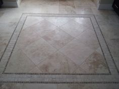 Travertine 18 x 18 tile rug in master bathroom.  To learn more visit us at www.capellinteriors.com
