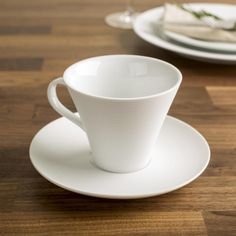These simple white porcelain cup and saucer sets are perfect for any decor. Durable porcelain construction is dishwasher safe and great for everyday family meals or special occasions.