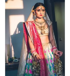 A closer look at this gorgeous bride. The jewelry is just out of this world!  #fashionfriday #flashbackfriday #fbf #rohitbahl #indiandesigners #templejewelry #indianbrides #desibrides #vogueIndia #vogue #makeinindia #madeinindia #indianweddings #desiweddings #bridesmaids #maidofhonor #friends #girlfriends #indiantrends #bridalcouture #chic #shaadi #anarkali #lehenga #indiansuits #indianwear #indianfashion #fivenblock #fnbliving by fivenblock