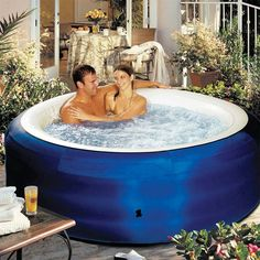 Inflatable 4 person hot tub.... now my husband can have his hot tub
