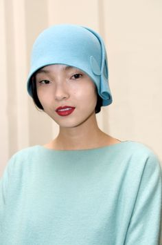 Backstage Cacharel Fall Winter 2012-2013 collection.  I WANT that hat!
