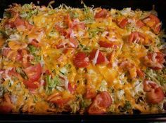 Taco Casserole 1 7oz. bag Nacho Cheese Doritos, crushed 1 lb. hamburger, browned 1 pkg. taco seasoning, mixed according to directions 1 (8 oz.) pkg. shredded Cheddar cheese 1 (8 oz.) pkg. shredded Mozzarella cheese Shredded Lettuce Sliced tomato Layer ingredients in 9 x 13 pan as listed - crushed chips, meat and seasonings, 2/3 of cheese, lettuce, tomato, and remaining cheese. Bake at 350 degrees for 15 minutes.