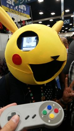 Saw this at comic con! Each eye has a playable Pokémon yellow!