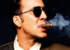Nicholas Cage Not Confirmed To Join Sylvester Stallone And His Badass Crew In Expendables 3 Nicolas Cage, Famous Cigars, People Smoking, The Expendables, Look At The Stars, Cigar Smoking, Sylvester Stallone, American Actors, Beautiful Men