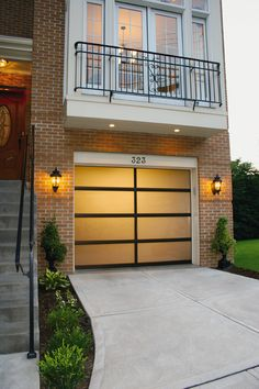 Full view aluminum glass garage doors give your home a modern look. Doors can be powder coated almost any colour you choose. Door Makeover, House Design, Modern Garage Doors, Garage, Garage Doors, Curb Appeal, Garage Door Makeover, Doors, Garage Door Types