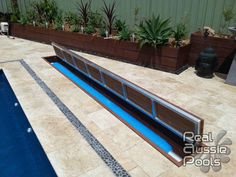Hide your pool cover under ground, out-of-sight when not in use. The Aussie UnderCover® is the only truly hidden pool cover system that can be tiled! Swimming Pools Backyard, Swimming Pool Designs, Pool Decks, Pool Landscaping, Pool Cover Roller, Underground Pool, Hidden Pool, Piscina Interior, Fiberglass Pools