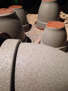 Spray painting plastic pots to look like stone!