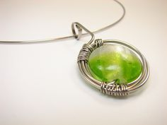 Zelené+oko+Přívěsek+z+chirurgické+oceli+s+vinutkou.+Obruč+součástí.