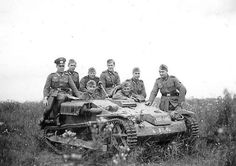 German soldiers posing on a small French Chenillette Renault UE, France, May-June 1940.