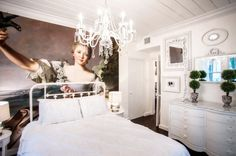 A French Wall Mural Dazzles in a Chic Bedroom...