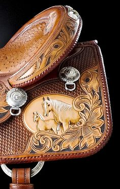 Closeup of Tooled Western Saddle! to cute and there palominos!!!!!