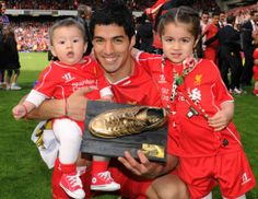 Luis Suarez with his children after the final game of the season against Newcastle at Anfield. #LFC