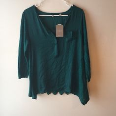 Final sale! NWT Anthropologie lace back sweater  Gorgeous new with tags Anthropologie emerald green lace back sweater from the knitted and knotted collection, the front is silk with a pocket and three buttons, the sides are sweater material with panels and the back is green lace! So pretty and perfect for St Patrick's Day!  Anthropologie Sweaters Crew & Scoop Necks