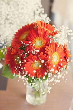 "There's something so frank and honest about gerberas and nothing says ""fall wedding"" like their fiery orange blooms. A modern option for a tablescape or an easy component of a bouquet, these flowers will stand out in the best possible way."