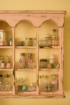 Meme's curio shelf with salt shakers or vinegar cruets with beads & sequins