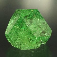 Tsavorite Superb tsavorite crystal. Excellent color with glassy faces. Has great clarity with a number of natural inclusions.  Size: 1.7 x 1.9 x 1.9 cm Country: Tanzania Locality: Arusha Region