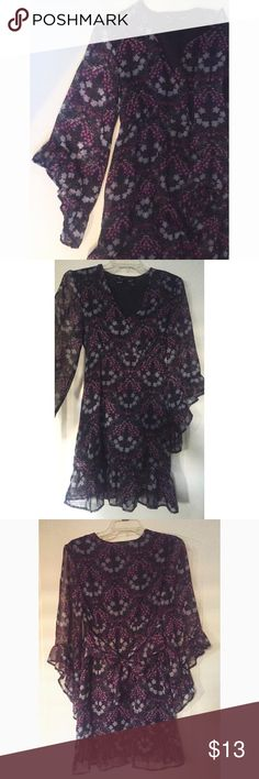 3/4 sleeve flowy dress 3/4 sleeve flowy floral printed purple dress. Sleeves are half see through. The dress has an underlining. Waist tie around the back. V-neck. Still in really good condition, no stains. Sorry, no trades. Like the item but not the price, feel free to make me a reasonable offer using the offer button below. Dresses Long Sleeve