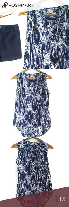 """GONE 10/1 ⏰ Blue Ikat Print Sleeveless V Neck Top Closet Closing Friday!! Last Chance!!   Slightly longer hem in the back makes for a nice loose fit. Cool, soft feel. Pairs nicely with navy bottoms or a crisp white skirt. Could also fit Medium.   {Materials} 100% Rayon   {Measurements} Bust: 19"""" Front Length: 23"""" Back Length: 26"""" Dalia Collection Tops"""