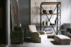 Studio Oliver Gustav in Copenhagen showcases furnishings for homes, such as this hemp-upholstered chair, left, contemporary Italian ceramics, top shelf, and centuries-old Cambodian pottery, middle shelf.