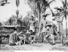 Singorkai, Huon Coast, New Guinea. 1944 March Four Japanese prisoners captured by soldiers of the Papuan Infantry Battalion are being interrogated by Lieutenant C. Bishop, Officer Commanding the platoon patrol. Sea Of Japan, History Projects, Prisoners Of War, Papua New Guinea, Armed Forces, World War Two, Wwii, Army, Japanese