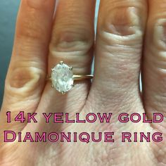 14k Yellow Gold Vintage Diamonique Ring This is a really pretty 14k yellow gold Vintage Diamonique Ring. Marked 14k DQ CZ. Size 5. The ring is in great vintage condition! Ready to wear w/ a beautifully clear stone that can fool most people I bet! My guess is that it's at least 2 carats but I'm not positive.. Perfect for that person that is rough on their jewelry or someone that travels a lot & doesn't want to take their priceless diamond w/ them! Please make REASONABLE offer using the offer…