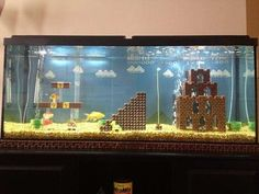 Michigan-based ad copywriter Cedrick Bearss recreated the iconic first level scene from Super Mario Bros inside his 55 gallon fish tank. Almost everything, including Mario, was made of LEGO bricks. Lego Super Mario, Super Mario Bros, Mario Bros., Lego Mario, Aquariums Super, Tanked Aquariums, Amazing Aquariums, Fish Aquariums, Deco Lego