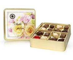 Výborné belgické pralinky ve zlaté bonboniéře se žlutými růžemi. Ice Tray