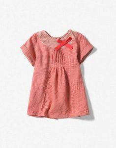 Simple dress with pintucks at the front, cute yoke and a bow.
