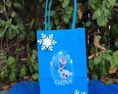 New Disney Movie Frozen!!!  Disney Princess Frozen… theme party favor bags!!!  this listing includes 6 favor bags. 3 of each character… but if you need more bags or specific colors please send us a message.  Please, make sure you order with 2 weeks of anticipation. Thank You