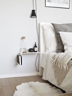 interesting side table and lighting for small space bedrooms | minimal light fixture pendant light shelf nightstand neutral light bright and airy