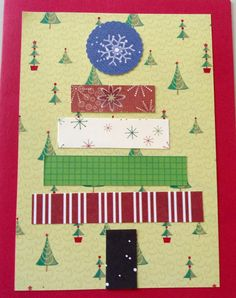 """A Christmas card! in June! Saw the idea in a mag - various strips of paper make the tree and trunk, the """"star"""" is a snowflake punched out of another paper. Took about 10 minutes to make, and part of that was locating my Christmas paper..."""