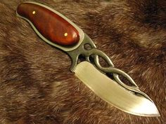 Twisted vine blade with cocobolo wood handle by Rancid Crabtree.