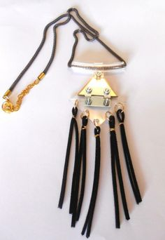 long handmade necklace with metal, pvc and leather materials