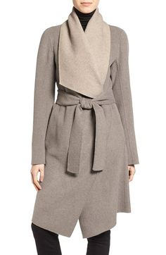 Free shipping and returns on Diane von Furstenberg Reversible Double Face Wrap Coat at Nordstrom.com. A broad collar reveals contrast on a reversible wrap coat crafted from a dense, double-faced wool blend. A reversible waist belt offers added styling versatility while also delineating the silhouette's transition from sleek and fitted to flared and feminine.