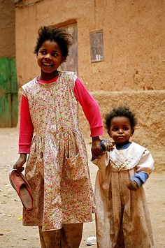 Sisters? holding hands -  Tinerhir, Morocco