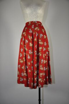 Keep the hair super feminine and the makeup young and fresh when you rock this skirt with a simple top that shows off a touch of cleavage. Rock some cute heels to polish the look and you will turn heads!! vintage floral print midi skirt