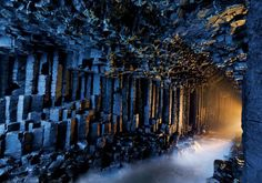 """Credit: Jim Richardson of National Geographic.Fingal's Cave is located on the uninhabited rock island ofStaffa,Scotland.This fascinating cave is formed from hexagon shaped basalt columns.The basalt formed into hexagonal columns when a lava flow cooled in the ocean. The lava flow that created Fingal's Cave also created the amazing Giant's Causeway rock formation In Gaelic,Fingal's Cave is known as Uamh-Binn, meaning """"cave of melody"""", due to the lovely sounds made by echos of waves crashing…"""