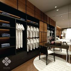 Simple and modern bedroom wardrobe with dark tones and unique hidden walking closet with wooden panel surface.  Designed by culturainterior  #interior #interiordesign #interiorinspiration #wardrobe #walkingcloset #bedroom #bedroominterior #houseinterior #interiorsemarang #interiorindonesia #culturainterior