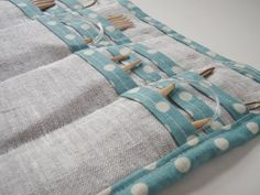 I love the way the blue and white polka dot cotton trim contrasts with the linen in this circular knitting needle case.