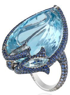 Ring from the Red Carpet collection in white gold 18ct set with a pear shaped aquamarine (58.44 cts), sapphires (5.73 cts), aquamarines and diamonds.