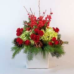 Fill your home with Christmas Cheer. This large arrangement is amazing for a mantle or as a decorative holiday piece