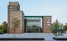 Hans-Sachs-Haus- von Gerkan, Marg & Partners: Gelsenkirchen, Germany  The 1927 City Hall designed by Alfred Fischer receives an addition in it's interior courtyard, preserving the beautiful brick facade.