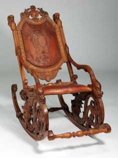 19th c. carved Venetian fantasy rocking chair : Lot 11