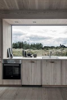 A contemporary weekend home in Skagen, Denmark with a modern rustic interior.